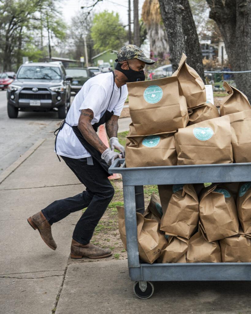 Man pushing cart with meal kits