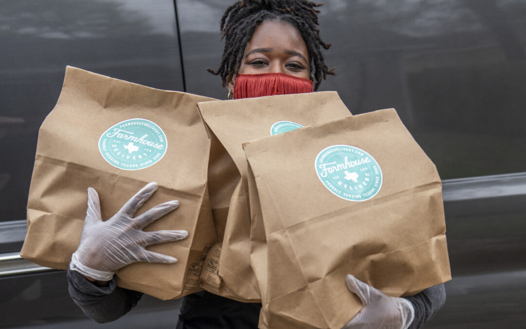 Woman holding meal kits